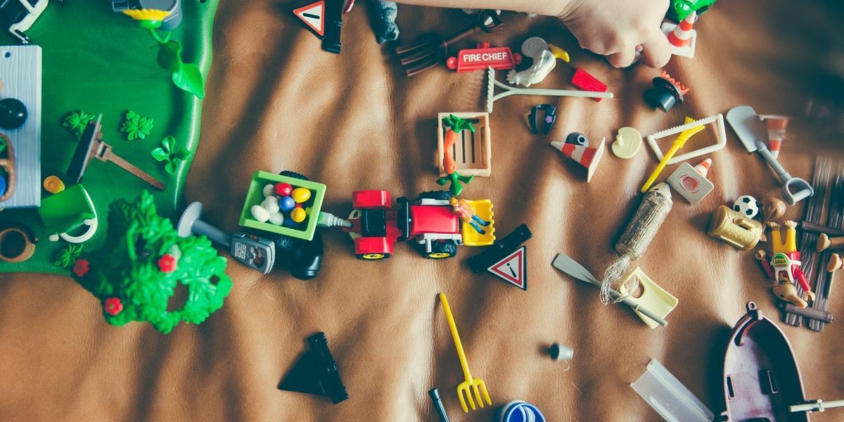 Toys scattered on blanket.